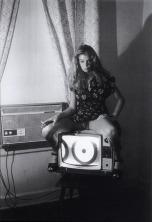 """Kristin DeBell sitting on TV Set (""""200 Motels Shot""""), 1976"""